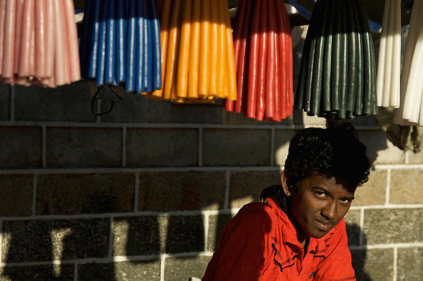 A boy is selling candles near a christian church near Bollywood, Mumabi India