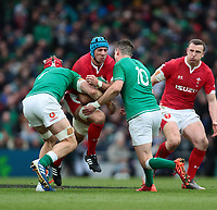 8th February 2020; Aviva Stadium, Dublin, Leinster, Ireland; International Six Nations Rugby, Ireland versus Wales; Justin Tipuric (Wales) is tackled by Josh van der Flier (Ireland) and Jonathan Sexton (Captain Ireland)