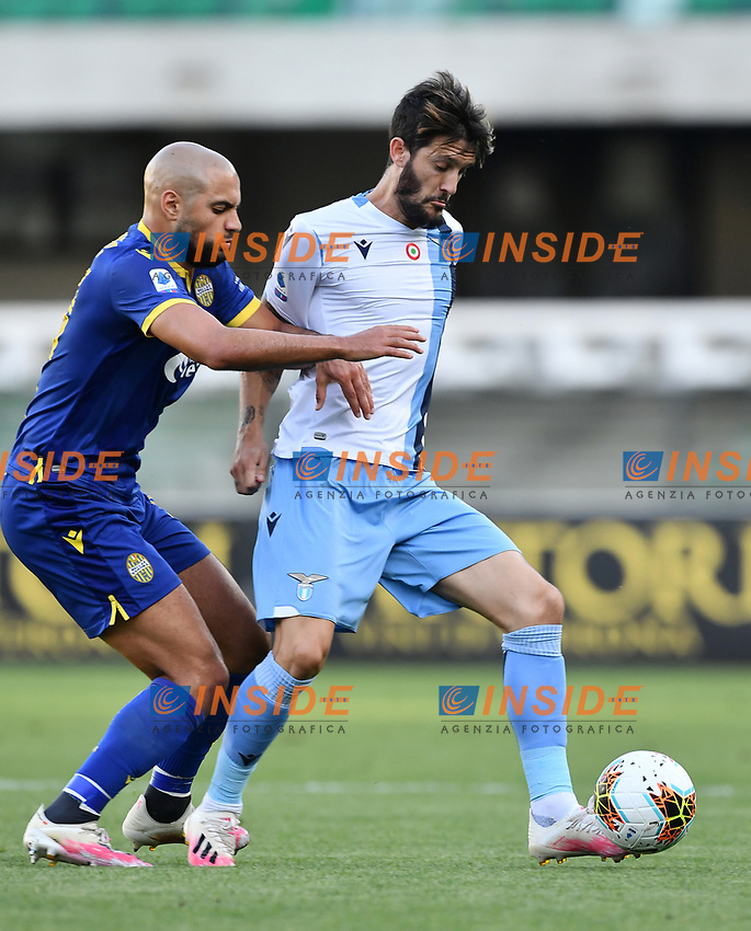 Sofyan Amrabat of Hellas Verona and \labe\compete for the ball during the Serie A football match between Hellas Verona and SS Lazio at stadio Marcantonio Bentegodi in Verona (Italy), July 26th, 2020. Play resumes behind closed doors following the outbreak of the coronavirus disease. <br /> Photo Daniele Buffa / Image Sport / Insidefoto
