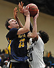 Kevin Voigt #23 of Massapequa, left, looks to drive to the net during the Nassau County varsity boys basketball Class AA semifinals against Baldwin at Farmingdale State College on Monday, Feb. 26, 2018. Baldwin won by a score of 50-41.