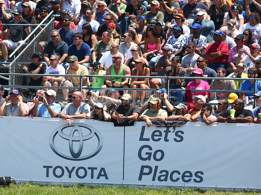 Jun. 1, 2014; Englishtown, NJ, USA; NHRA fans in the grandstands behind a Toyota logo during the Summernationals at Raceway Park. Mandatory Credit: Mark J. Rebilas-