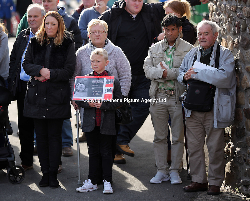 Pictured: A young boy with an album with pictures from the time joins other members of public gather to see Prince Charles at the Memorial Garden in Aberfan Friday 21 October 2016<br />