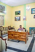 Built by Mario de la Cruz, Javier Luna Hernandez poses in his office of his soon to be restaurant in San Juan Chamula. Arquitectura Libre / Free Architecture, Chiapas, Mexico