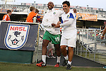 20 September 2014: New York's Marcos Senna (ESP) (19) and assistant coach Alecko Eskandarian (right). The Carolina RailHawks played the New York Cosmos at WakeMed Stadium in Cary, North Carolina in a 2014 North American Soccer League Fall Season match. Carolina won the game 5-4.
