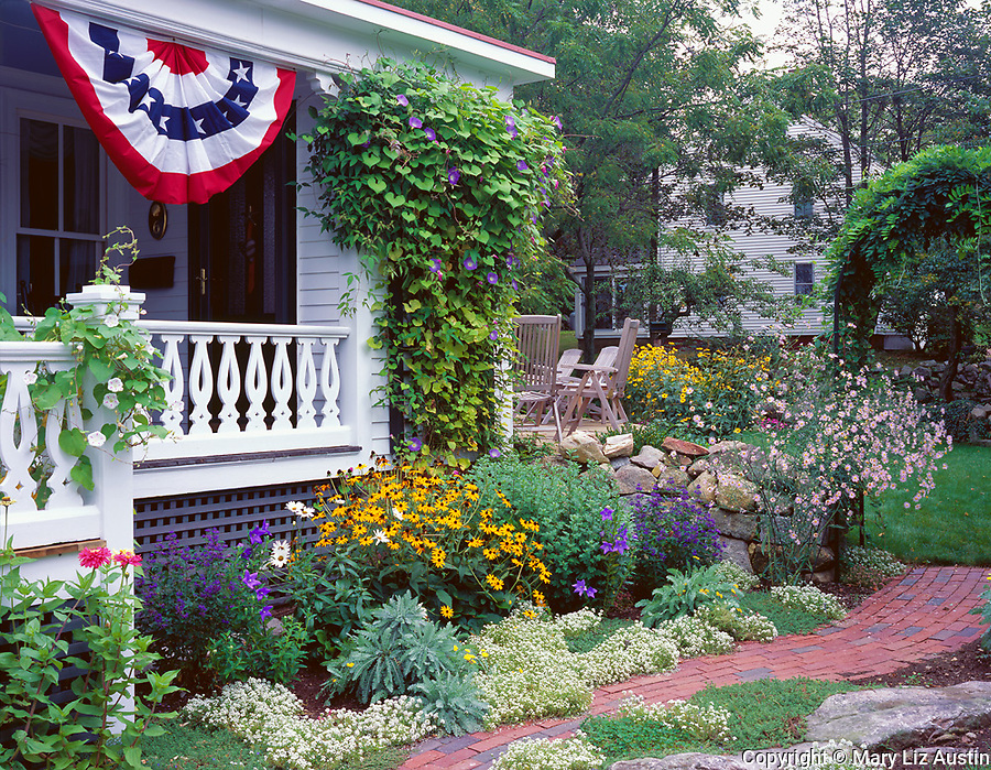 Rockport, Cape Ann, MA<br /> Summer flowers border the porch and pathway of a house in Rockport, MA