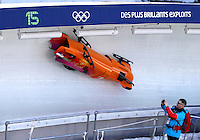 The Sloviakian two-man bobsleigh team, driven by Milan Jagnesak, crashes through turn 15 during two-man bobsleigh at the XXI Olympic Winter Games Thursday, February 18, 2010 at the Whistler Sliding Center in Whistler, British Columbia.