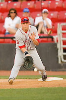 First baseman Chris McGuiness #24 of the Greenville Drive tries to field a low throw at  L.P. Frans Stadium May 8, 2010, in Hickory, North Carolina.  Photo by Brian Westerholt / Four Seam Images