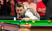 Mark Selby watches the red ball sail into the pocket during the Dafabet Masters Quarter Final 3 match between Ronnie O'Sullivan and Mark Selby at Alexandra Palace, London, England on 14 January 2016. Photo by Liam Smith / PRiME Media Images