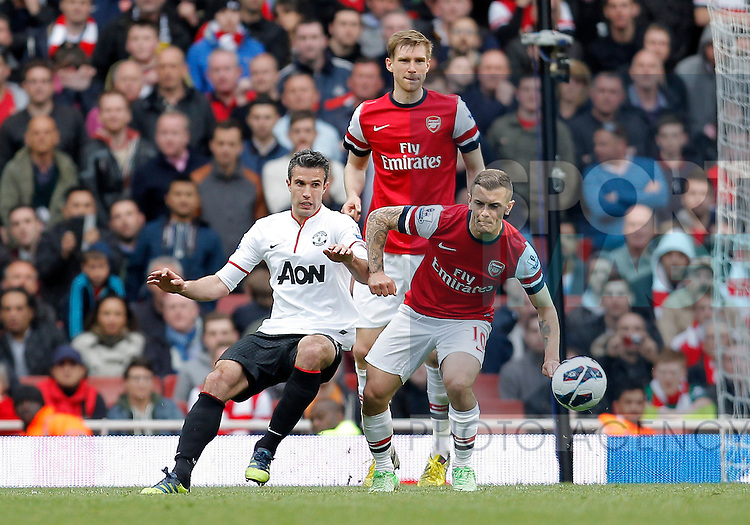 Robin van Persie of Manchester United competes with Jack Wilshere - Barclays Premier League - Arsenal vs Manchester United  - Emirates Stadium London - Season 12/13 - 28th April 2013 - Picture Malcolm Couzens/Sportimage
