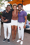 """Fashion designer Edwing D'Angelo (far right) posing with guests at his Edwing D'Angelo Spring Summer 2019 """"Pristine"""" collection fashion show at Sofrito in New York City on July 11, 2018; during New York Fashion Week: Men's Spring Summer 2019."""