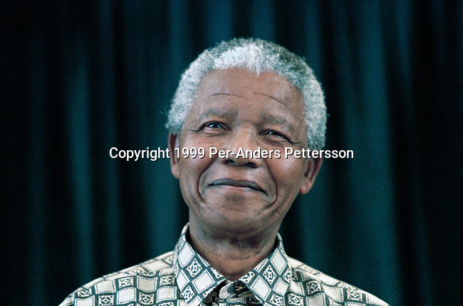 JOHANNESBURG, SOUTH AFRICA - MARCH 8: Former President Nelson Mandela of South Africa speaks to visitors on March 8, 1999 in his residence in Houghton, a suburb of Johannesburg, South Africa. The ANC freedom fighter was in prison for 27 years and released in 1990. He became President of South Africa after the first multiracial democratic elections in April 1994. Mr. Mandela retired after one term in 1999 and gave leadership to the current president Mr. Thabo Mbeki. (Photo by Per-Anders Pettersson)