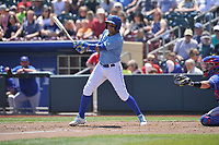Omaha Storm Chasers shortstop Ramon Torres (2) swings during a game against the Round Rock Express at Werner Park on May 29, 2017 in Omaha, Nebraska.  Omaha won 10-8.  (Dennis Hubbard/Four Seam Images)