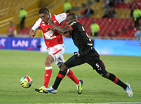 BOGOTA -COLOMBIA- 29 -09-2013. Silvio Gonzalez (Izq) de Independiente Santa Fe  disputa el balon contra Dayron Mosquera (Der)  del Independiente Medellin  , partido correspondiente a la doceava fecha de La Liga Postobon segundo semestre jugado en el estadio Nemesio Camacho El Campin /   Silvio Gonzalez (L) of Independiente Santa Fe dispute the ball against Dauron Mosquera (R) of Independiente Medellin, the twelfth game in La Liga Postobon date second half played in the Estadio Nemesio Camacho El Campin  .Photo: VizzorImage / Felipe Caicedo / Staff