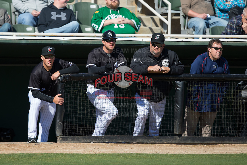 (L-R) Kannapolis Intimidators hitting coach Justin Jirschele (9), manager Cole Armstrong (33), pitching coach Brian Drahman and trainer Joe Geck watch the action from the dugout during the game against the Delmarva Shorebirds at Kannapolis Intimidators Stadium on April 13, 2016 in Kannapolis, North Carolina.  The Intimidators defeated the Shorebirds 8-7.  (Brian Westerholt/Four Seam Images)