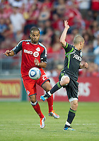Toronto FC forward Maicon Santos #29 and Seattle Sounders FC midfielder Osvaldo Alonso #6 in action during an MLS game between the Seattle Sounders FC and the Toronto FC at BMO Field in Toronto on June 18, 2011..The Seattle Sounders FC won 1-0.
