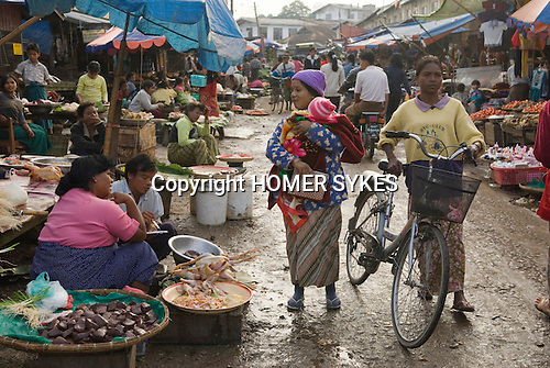A young mother brings her new born son to the market to show her friends. Pyin U Lwin Myanmar (formally known as Maymyo Burma.) 2006 Myanmar