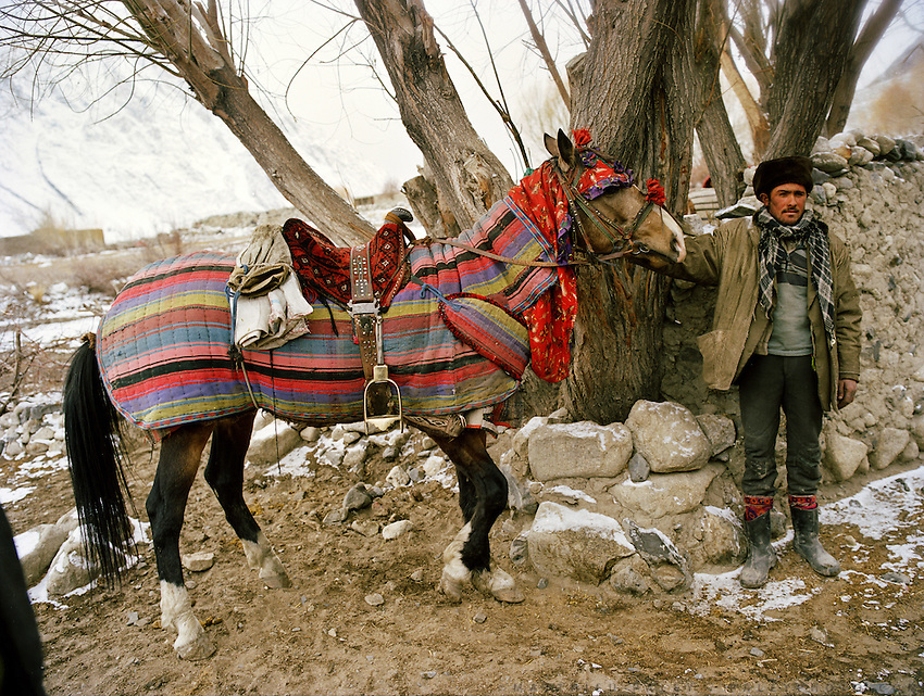 Invited party come by horse. Wedding celebration of Dodé Khuda, at Safar Boi house, in Tchehel-Kand village..Wakhi wedding ceremonies usually takes place in the winter months. The Wakhi do most of their business with Afghan Kyrgyz..Winter expedition through the Wakhan Corridor and into the Afghan Pamir mountains, to document the life of the Afghan Kyrgyz tribe. January/February 2008. Afghanistan