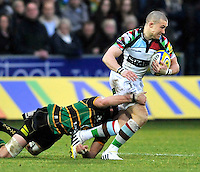 Northampton, England. Mike Brown of Harlequins tackled during the Aviva Premiership match between Northampton Saints and Harlequins at Franklin's Gardens on December 22. 2012 in Northampton, England.