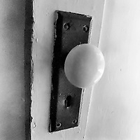 A vintage antique doorknob on a historic building, Koreshan State Park, Koreshan Unity Settlement Historic site, Estero, FL  July 2018. Shot with a Canon EOS 650 35mm SLR camera on Kodak T-Max 400 film. (Photo by Brian Cleary/ www.bcpix.com )