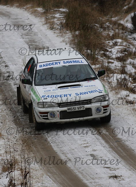 Alasdair Anderson - Richard Sutherland at junction 8 on Special Stage 4 Bewshaugh on the Brick & Steel Border Counties Rally 2013, Round 2 of the RAC MSA Scottish Rally Championship sponsored by ARR Craib Transport Limited which was organised by Whickham & District and Hawick & Border Car Clubs and based in Jedburgh and held in Kielder Forest on 22.3.13.