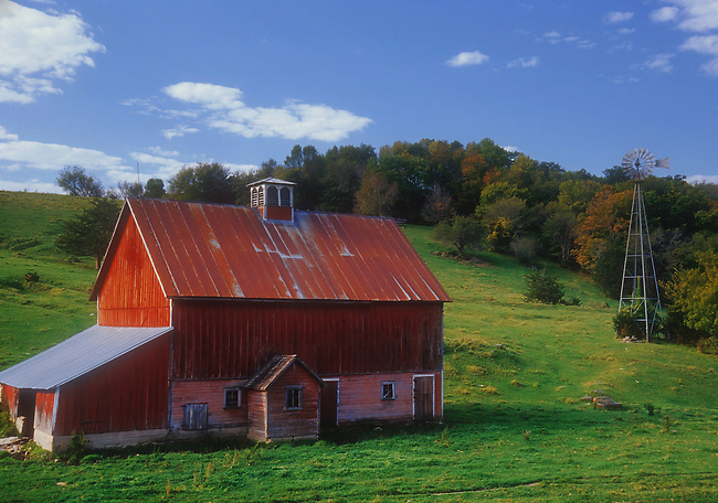 An Amish red barn sits in a green valley in late summer in Fillmore County, Minnesota