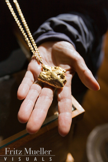 Gold nugget at placer mine in the Klondike near Dawson City, Yukon