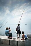 PHILIPPINES, Manila, fishing at the Rojas Blvd Bay Walk