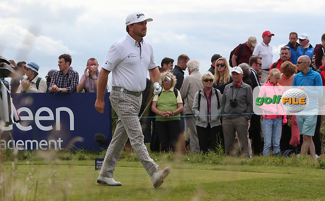 Graeme McDowell (NIR) on his way from the 3rd during Round Three of the 2015 Aberdeen Asset Management Scottish Open, played at Gullane Golf Club, Gullane, East Lothian, Scotland. /11/07/2015/. Picture: Golffile | David Lloyd<br /> <br /> All photos usage must carry mandatory copyright credit (&copy; Golffile | David Lloyd)