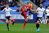 Jonathan Hogg of Huddersfield Town tries to control the ball  from Aaron Wilbraham of Bolton Wanderers during Bolton Wanderers vs Huddersfield Town, Emirates FA Cup Football at the Macron Stadium on 6th January 2018