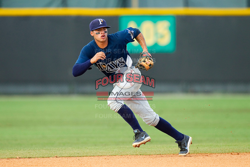 Princeton Rays shortstop Douglas Duran (7) tracks a ground ball against the Burlington Royals at Burlington Athletic Park on July 5, 2013 in Burlington, North Carolina.  The Royals defeated the Rays 5-1 in game one of a doubleheader.  (Brian Westerholt/Four Seam Images)