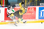 Stockholm 2014-11-16 Ishockey Hockeyallsvenskan AIK - IF Bj&ouml;rkl&ouml;ven :  <br /> AIK:s Ryan McKiernan tacklar Bj&ouml;rkl&ouml;vens Alexander Ribbenstrand under matchen mellan AIK och IF Bj&ouml;rkl&ouml;ven <br /> (Foto: Kenta J&ouml;nsson) Nyckelord:  AIK Gnaget Hockeyallsvenskan Allsvenskan Hovet Johanneshov Isstadion Bj&ouml;rkl&ouml;ven L&ouml;ven IFB slagsm&aring;l br&aring;k fight fajt gruff