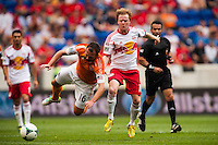 Dax McCarty (11) of the New York Red Bulls knocks Adam Moffat (16) of the Houston Dynamo off the ball during a Major League Soccer (MLS) match at Red Bull Arena in Harrison, NJ, on June 30, 2013.