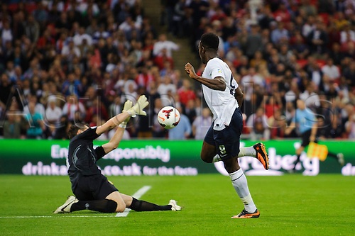 06.09.2013 London, England. England Forward Danny Welbeck (Manchester United) scores England 4th goal past Moldova Goalkeeper Stanislav Namasco (Domzale) during the second half of the 2014 FIFA World Cup Qualifier between England and Moldova at Wembley Stadium.