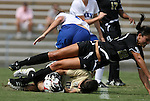 28 August 2009: Central Florida's Lynzee Lee (00) grabs the ball at the feet of Central Florida's Christina Petrucco (22) and Duke's KayAnne Gummersall (in white). The Duke University Blue Devils lost 3-2 to the University of Central Florida Knights at Fetzer Field in Chapel Hill, North Carolina in an NCAA Division I Women's college soccer game.