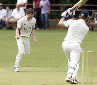 Ed Bird (L) of North Middlesex celebrates after bowling Steve Clark during the Middlesex County Cricket League Premier Division  game between Hampstead and North Middlesex at Lymington Road, Hampstead on Sat July 19, 2014