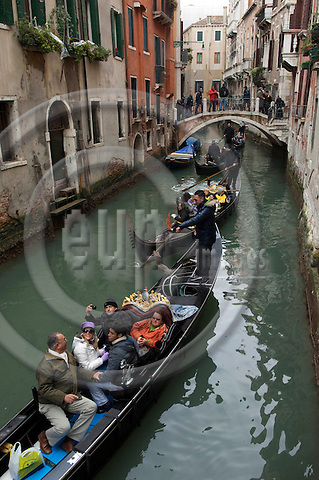 San Marco-Venice-Italy - January 27, 2011 -- Gondoliers manoeuvre their gondolas with tourists on Rio del Barcaroli -- water, transport, infrastructure, tourism -- Photo: Horst Wagner / eup-images