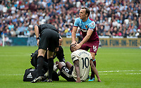 Mark Noble of West Ham Utd checks on injured Marcus Rashford of Man Utd during the Premier League match between West Ham United and Manchester United at the Olympic Park, London, England on 22 September 2019. Photo by Andy Rowland / PRiME Media Images.