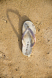 INDONESIA, Flores, Riung, a flip flop that has washed up onto the sand at Rutong island