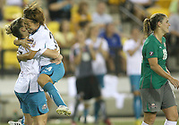 Cat Whitehill #84 of Abby's XI turns away as Aya Miyama #24 and Amy Rodriguez #17 of Marta's XI celebrate Rodriguez goal during the WPS All-Star game at KSU Stadium in Kennesaw, Georgia on June 30 2010. Marta XI won 5-2.