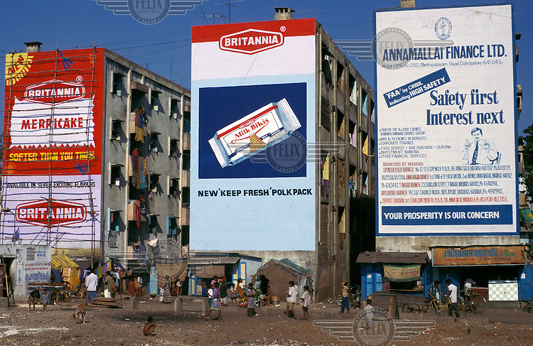 Hand painted advertising hoardings painted on the end walls of housing blocks.