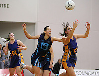 Hamilton's Joanna Trip, left, and Otago's Te Paea Selby-Rickit compete for the ball in the Lion Foundation Netball Championship final match, day five, MoreFM Arena, Dunedin, New Zealand, Friday, October 04, 2013. Credit: Dianne Manson/©MBPHOTO /Michael Bradley Photography.