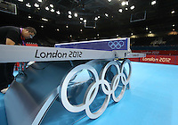 24.07.2012. London England. A Table to Be used in The 2012 Olympics Table Tennis Event with The Rainbow Arch Plus Olympic rings Shape AT Competition Venue Excel in London
