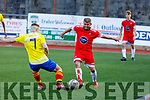 Darcy O'Sullivan of Classic FC and Billy Stack of Tralee Dynamos go toe to toe for possession in the Denny Premier  soccer league on Sunday in Mounthawk Park.