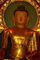 Golden statue of Buddha inside a monastery in the Himayan foothills of Sikkim, India