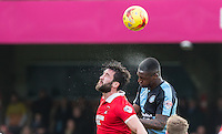 Anthony Stewart of Wycombe Wanderers beats Ollie Palmer of Leyton Orient in the air during the Sky Bet League 2 match between Wycombe Wanderers and Leyton Orient at Adams Park, High Wycombe, England on 23 January 2016. Photo by Andy Rowland / PRiME Media Images.