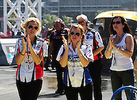 Apr. 3, 2011; Las Vegas, NV, USA: NHRA funny car driver Courtney Force (left), sister Brittany Force (center) and mother Laurie Force during the Summitracing.com Nationals at The Strip in Las Vegas. Mandatory Credit: Mark J. Rebilas-