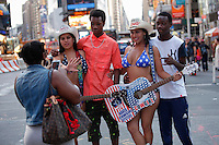 Naked street performers gather in Times Square on July 20, 2014 in New York City. Kena BetancurVIEWpress