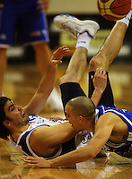 Adrian Majstrovich tumbles in the challenge of Saints guard Lindsay Tait during the NBL Round 14 basketball match between the Wellington Saints and Auckland Stars at TSB Bank Arena, Wellington, New Zealand on Thursday 29 May 2008. Photo: Dave Lintott / lintottphoto.co.nz
