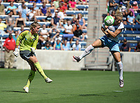 Chicago forward Ella Masar (3) just misses blocking a clearance by Boston goalkeeper Alyssa Naeher (1).  The Boston Breakers defeated the Chicago Red Stars 3-1 at Toyota Park in Bridgeview, IL on July 25, 2010