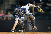 Charleston RiverDogs catcher Collin Slaybaugh (16) chases after the baseball during the game against the Hickory Crawdads at L.P. Frans Stadium on August 25, 2015 in Hickory, North Carolina.  The Crawdads defeated the RiverDogs 7-4.  (Brian Westerholt/Four Seam Images)